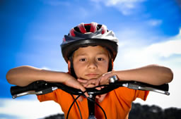 Child on bike with helmet