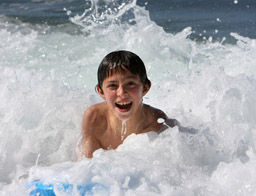 Kid in waves